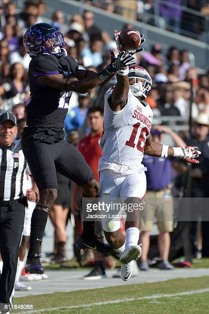 Cornerback Michiah Quick of the Oklahoma Sooners breaks up a pass intended for wide receiver Taj Williams of the TCU Horned Frogs on October 1 2016...
