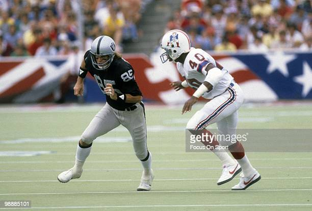 Cornerback Mike Haynes of the New England Patriots guarding wide receiver Bob Chandler of the Oakland Raiders November 1 1981 during an NFL football...