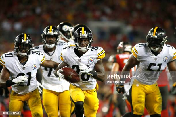 Cornerback Mike Hilton of the Pittsburgh Steelers runs with the ball following his interception during the second quarter of a game against the Tampa...