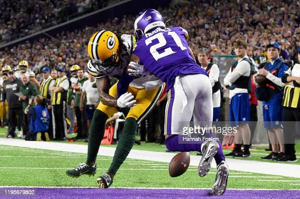 Cornerback Mike Hughes of the Minnesota Vikings celebrates after breaking up a pass to wide receiver Davante Adams of the Green Bay Packers during...