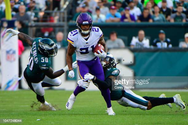 Cornerback Mike Hughes of the Minnesota Vikings is tackled by runs the ball against linebacker LaRoy Reynolds and cornerback Avonte Maddox of the...