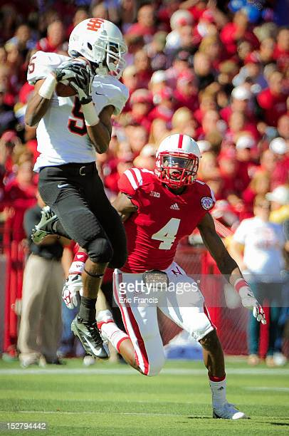 Cornerback Mohammed Seisay of the Nebraska Cornhuskers zeros in on wide receiver Richard Blackmon II of the Idaho State Bengals during their game at...
