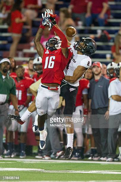 Cornerback Montell Garner of the South Alabama Jaguars breaks up a pass to wide receiver Fatu Moala of the Southern Utah Thunderbirds during the...