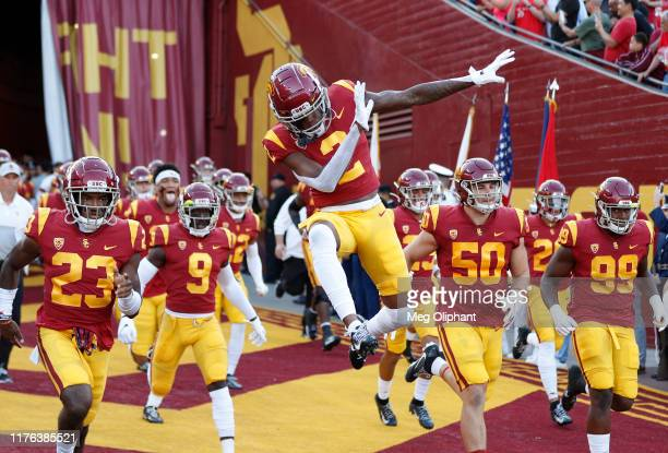 Cornerback Olaijah Griffin of the USC Trojans jumps as he runs out to the field for the game against the Utah Utes at Los Angeles Memorial Coliseum...