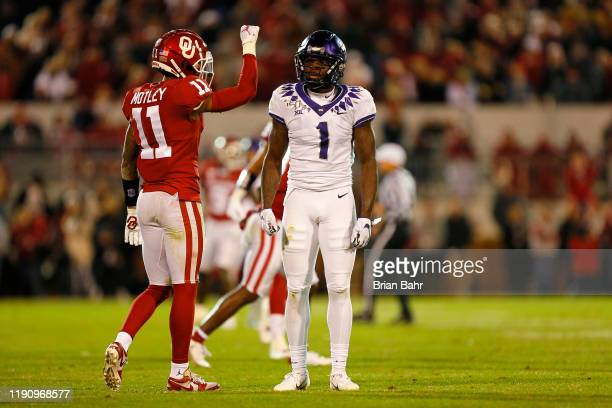 Cornerback Parnell Motley of the Oklahoma Sooners celebrates against wide receiver Jalen Reagor of the TCU Horned Frogs late in the game on November...