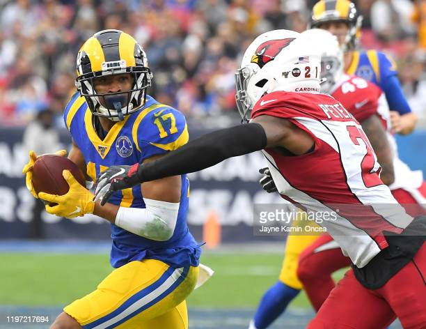 Cornerback Patrick Peterson of the Arizona Cardinals chases down wide receiver Robert Woods of the Los Angeles Rams after a complete pass in the game...