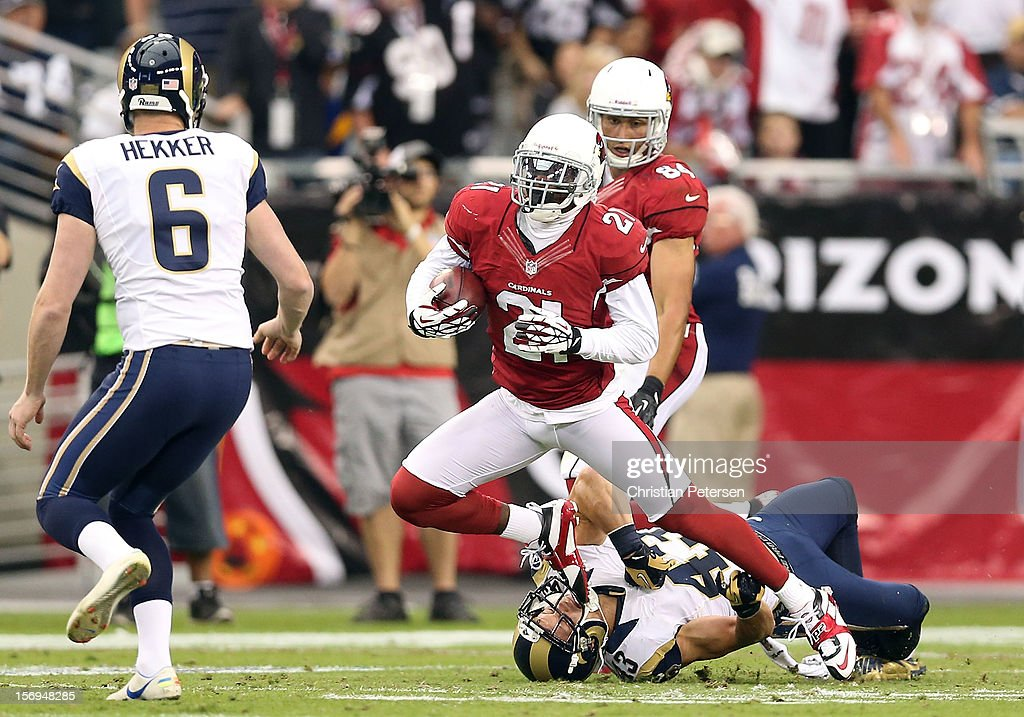Cornerback Patrick Peterson #21 of the Arizona Cardinals returns a punt past strong safety Craig Dahl #43 of the St. Louis Rams during the NFL game at the University of Phoenix Stadium on November 25, 2012 in Glendale, Arizona. The Rams defeated the Cardinals 31-17.
