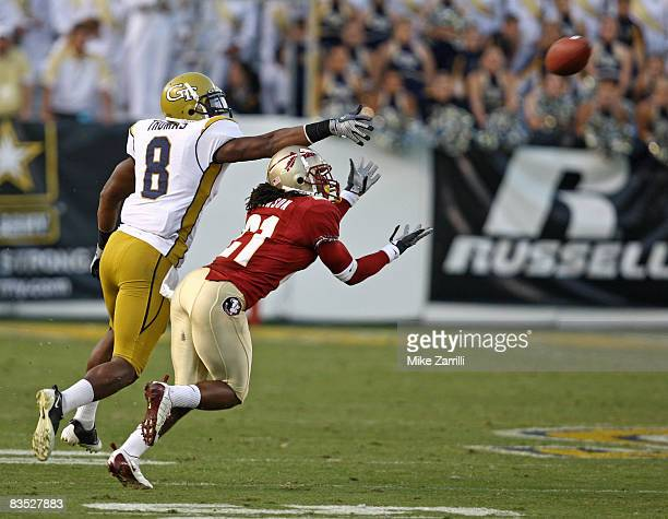 Cornerback Patrick Robinson of the Florida State Seminoles gets position to intercept a fourth quarter pass while wide receiver Demaryius Thomas of...