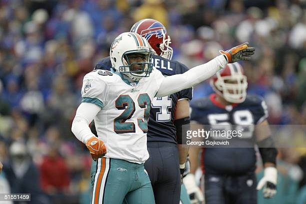 Cornerback Patrick Surtain of the Miami Dolphins signals to the sideline during a game against the Buffalo Bills on October 17 2004 at Ralph Wilson...