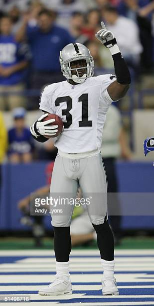 Cornerback Phillip Buchanon of the Oakland Raiders celebrates int he endzone during the game against the Indianapolis Colts at the RCA Dome on...