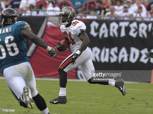 Cornerback Phillip Buchanon of the Tampa Bay Buccaneers returns a kick against the Jacksonville Jaguars at Raymond James Stadium on October 28 2007...