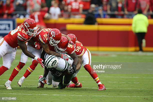 Cornerback Phillip Gaines Defensive End Jaye Howard and Linebacker Derrick Johnson of the Kansas City Chiefs tackle Running Back Matt Forte of the...