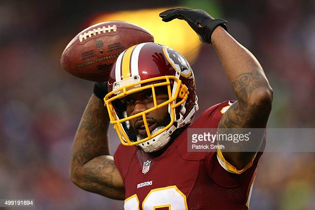 Cornerback Quinton Dunbar of the Washington Redskins celebrates after a third quarter interception against the New York Giants at FedExField on...