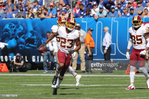 Cornerback Quinton Dunbar of the Washington Redskins has the second of two Interceptions against the New York Giants in the first half at MetLife...
