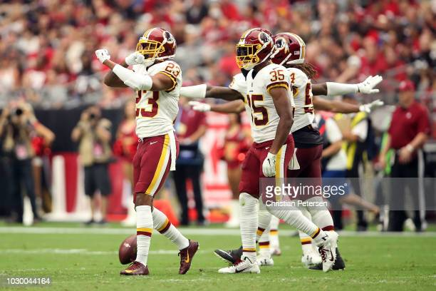 Cornerback Quinton Dunbar of the Washington Redskins reacts with teammate defensive back Montae Nicholson after a play during the third quarter...