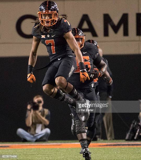 Cornerback Ramon Richards of the Oklahoma State Cowboys celebrates after Texas Tech missed an extra point kick during the second half of a NCAA...