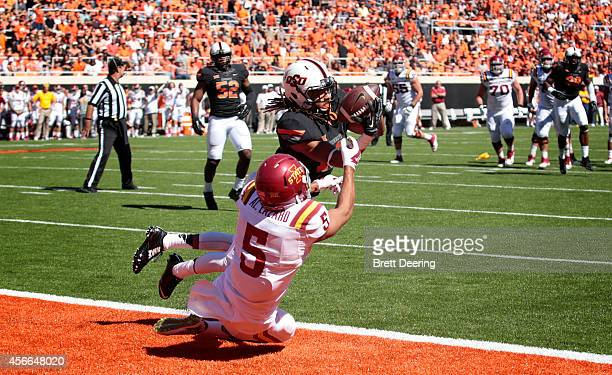 Cornerback Ramon Richards of the Oklahoma State Cowboys intercepts the ball in front of wide receiver Allen Lazard of the Iowa State Cyclones October...