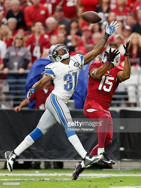 Cornerback Rashean Mathis of the Detroit Lions breaks up a pass intended for wide receiver Michael Floyd of the Arizona Cardinals in the first...