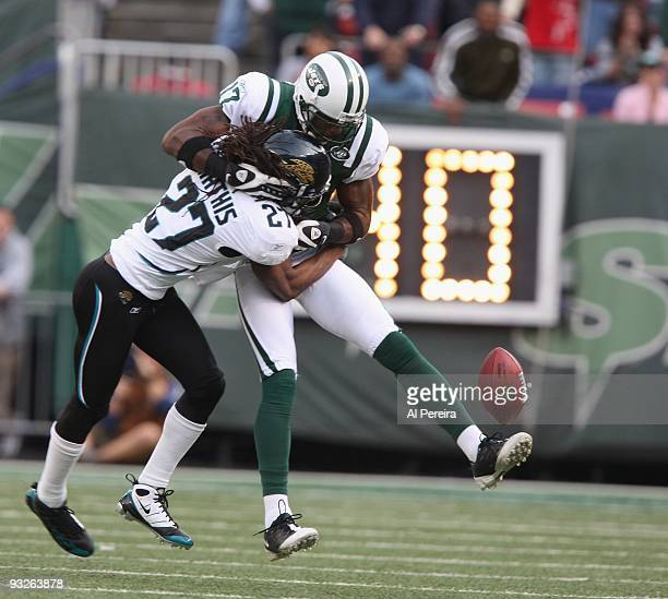 Cornerback Rasheen Mathis of the Jacksonville Jaguars causes a fumble after Wide Receiver Braylon Edwards of the New York Jets has a long gain when...