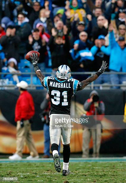Cornerback Richard Marshall of the Carolina Panthers reacts to the fans after recovering a fumble in the final minutes of the second half against the...