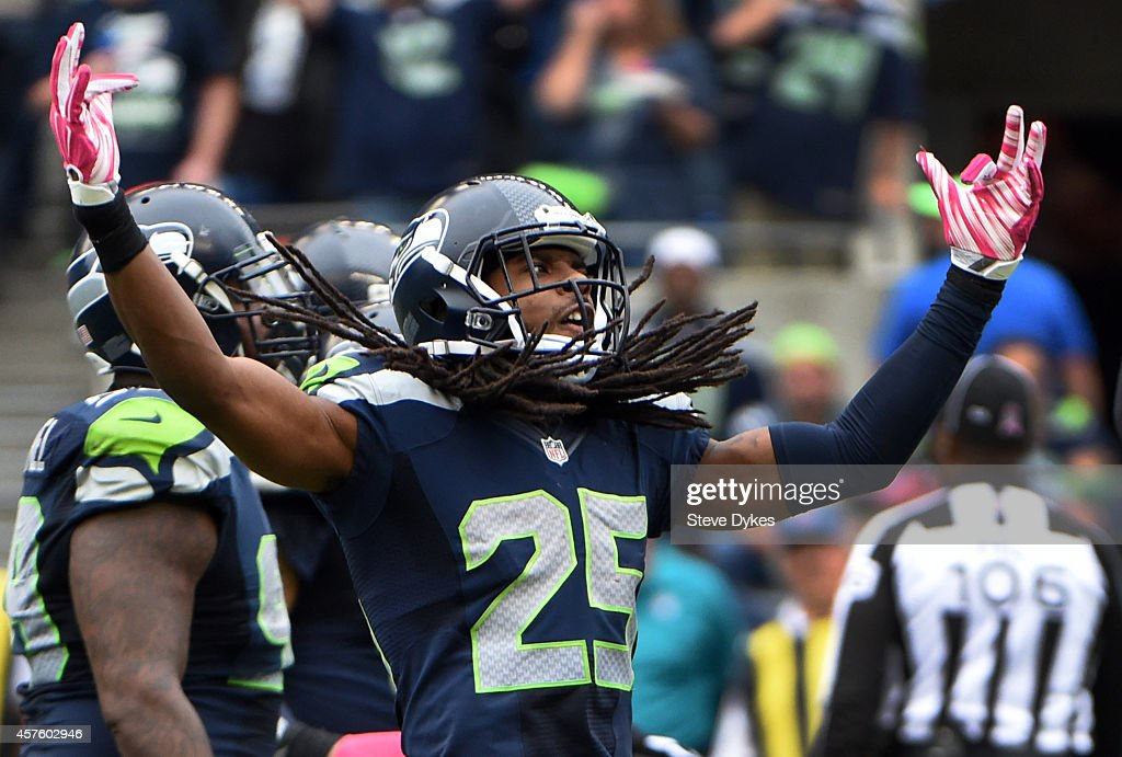 Cornerback Richard Sherman #25 dances around on the field during the third quarter of the game against the Dallas Cowboys at CenturyLink Field on October 12, 2014 in Seattle,Washington.