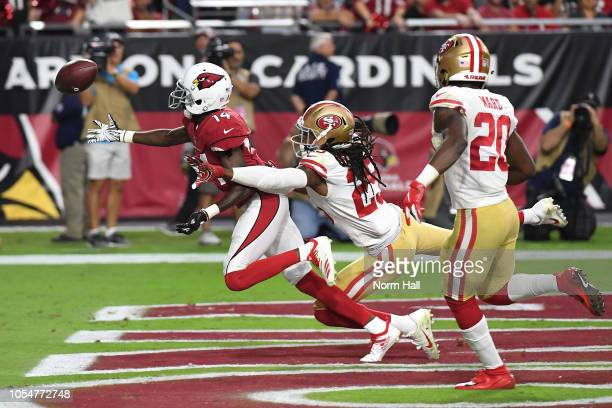 Cornerback Richard Sherman of the San Francisco 49ers knocks the ball away from wide receiver JJ Nelson of the Arizona Cardinals during the fourth...