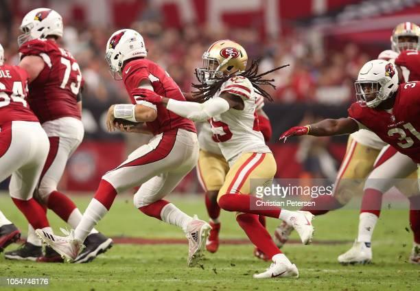 Cornerback Richard Sherman of the San Francisco 49ers sacks quarterback Josh Rosen of the Arizona Cardinals during the second quarter at State Farm...