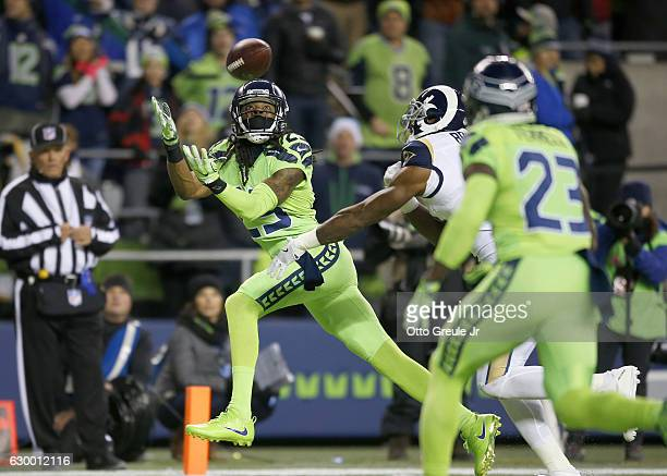 Cornerback Richard Sherman of the Seattle Seahawks almost intercepts a pass by the Los Angeles Rams at CenturyLink Field on December 15, 2016 in...