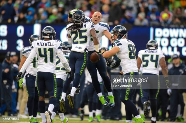 Cornerback Richard Sherman of the Seattle Seahawks celebrates after an interception in the 1st half against the New York Giants at MetLife Stadium on...