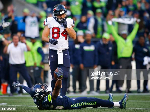 Cornerback Richard Sherman of the Seattle Seahawks celebrates his interception with 16 seconds left in the game as tight end Ryan Griffin of the...