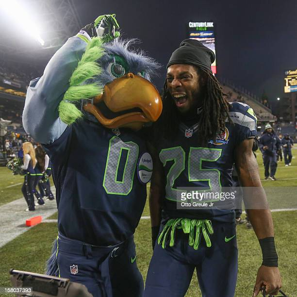 Cornerback Richard Sherman of the Seattle Seahawks celebrates with Seahawks' mascot Blitz after the game against the Arizona Cardinals at CenturyLink...