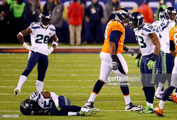 Cornerback Richard Sherman of the Seattle Seahawks lays on the field after a play in the third quarter against the Denver Broncos during Super Bowl...