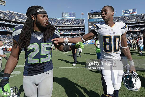Cornerback Richard Sherman of the Seattle Seahawks shakes hands with wide receiver Malcom Floyd of the San Diego Chargers after the Chargers defeated...