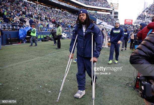 Cornerback Richard Sherman of the Seattle Seahawks walks on the sidelines in the third quarter against the Arizona Cardinals at CenturyLink Field on...