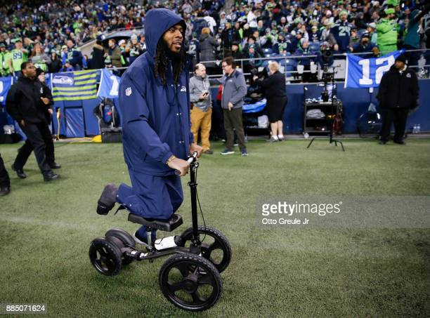 Cornerback Richard Sherman of the Seattle Seahawks wheels around the sidelines before the game against the Philadelphia Eagles in the third quarter...