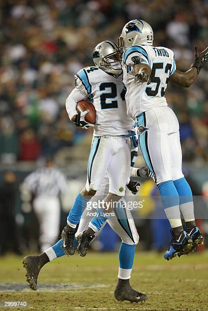 Cornerback Ricky Manning Jr #24 of the Carolina Panthers bumps chests with teammate linebacker Greg Favors after making an interception during the...