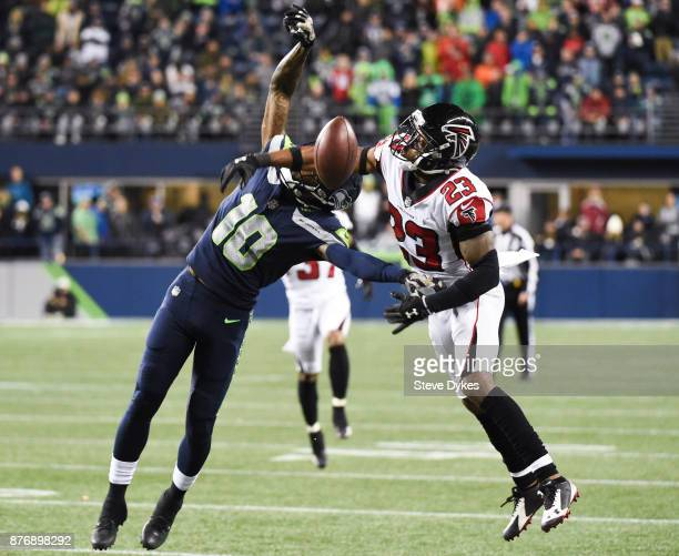 Cornerback Robert Alford of the Atlanta Falcons gets called for pass interference on wide receiver Paul Richardson of the Seattle Seahawks during the...
