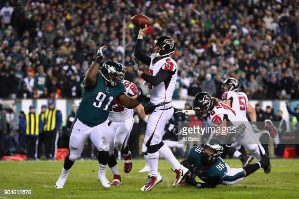 Cornerback Robert Alford of the Atlanta Falcons throws a pass against defensive tackle Fletcher Cox of the Philadelphia Eagles during the second...