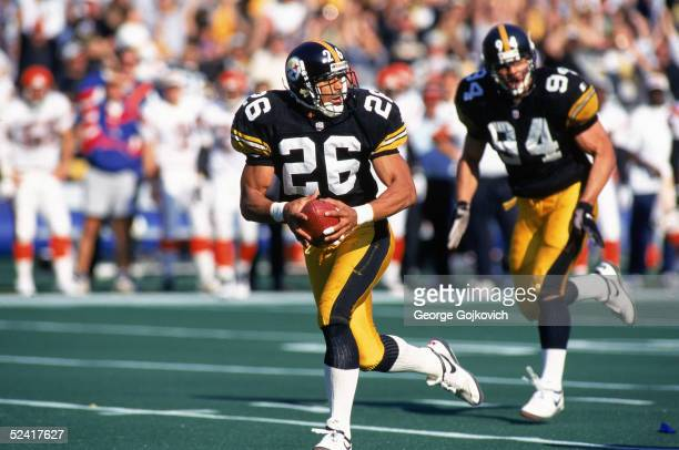 Cornerback Rod Woodson of the Pittsburgh Steelers returns a Jeff Blake fumble for a touchdown during an NFL game against the Cincinnati Bengals on...