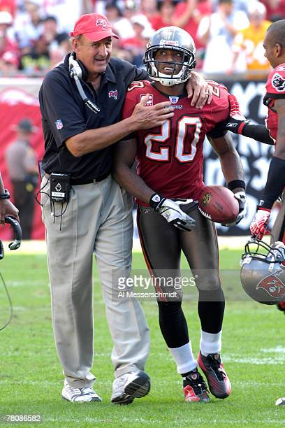 Cornerback Ronde Barber and defensive coordinator Monte Kiffin of the Tampa Bay Buccaneers celebrate an interception against the Washington Redskins...