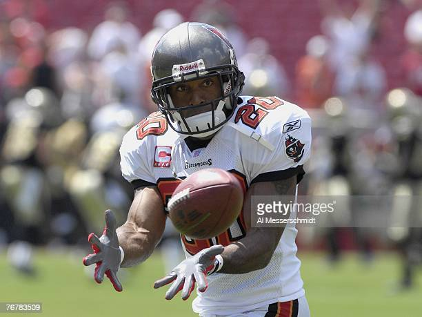 Cornerback Ronde Barber of the Tampa Bay Buccaneers grabs a warmup pass before play against the New Orleans Saints during a weektwo NFL game on...