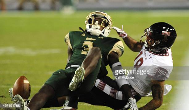 Cornerback Ronnie Hoggins of the South Florida Bull breaks up a pass intended for defensive back Sean Chandler of the Temple Owls in the first...