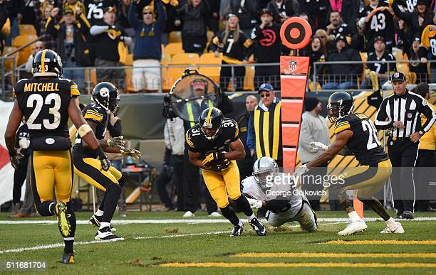 Cornerback Ross Cockrell of the Pittsburgh Steelers intercepts a pass against tight end Clive Walford of the Oakland Raiders as defensive backs...