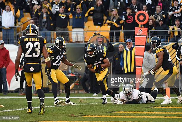 Cornerback Ross Cockrell of the Pittsburgh Steelers runs with the football after intercepting a pass intended for tight end Clive Walford of the...