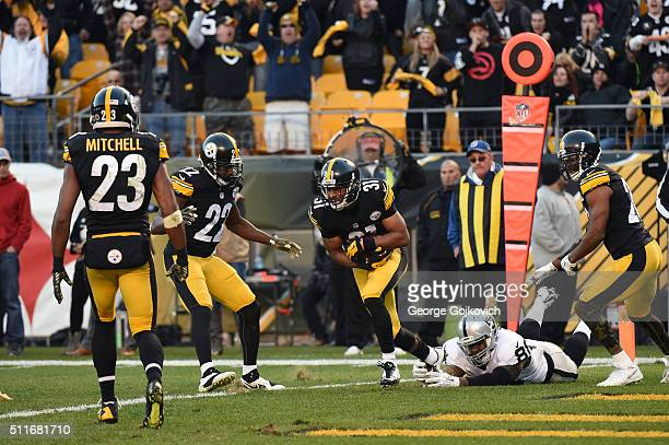 Cornerback Ross Cockrell of the Pittsburgh Steelers runs with the football after intercepting a pass against tight end Clive Walford of the Oakland...