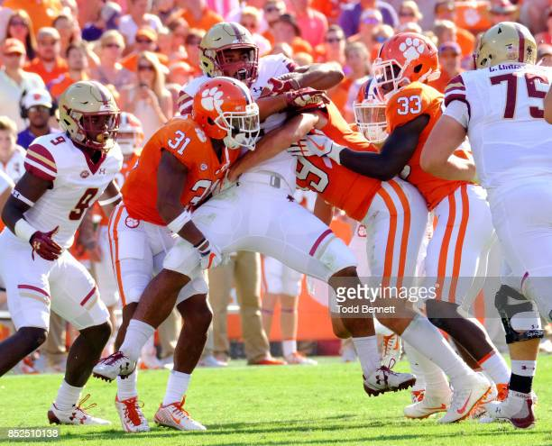 Cornerback Ryan Carter and safety Tanner Muse of the Clemson Tigers stop running back AJ Dillon of the Boston College Eagles at Memorial Stadium on...