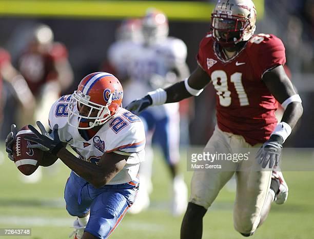 Cornerback Ryan Smith of the Florida Gators intercepts the ball as wide receiver De'Cody Fagg of the Florida State Seminoles looks on on November 25...