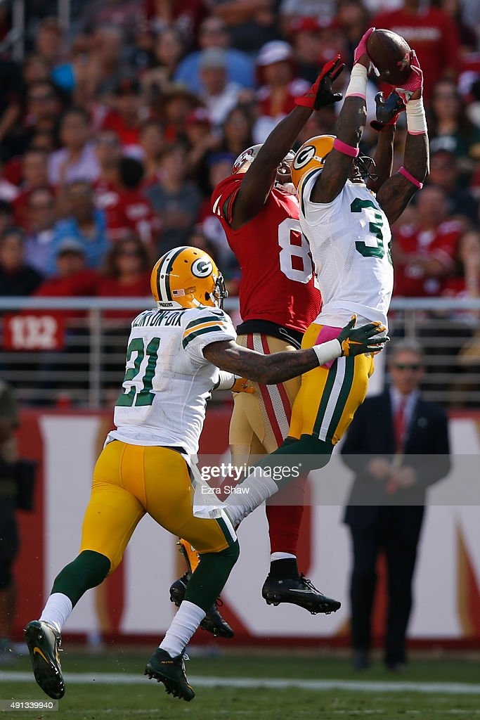 Cornerback Sam Shields #37 of the Green Bay Packers intercepts a pass from quarterback Colin Kaepernick #7 of the San Francisco 49ers during their NFL game at Levi's Stadium on October 4, 2015 in Santa Clara, California.