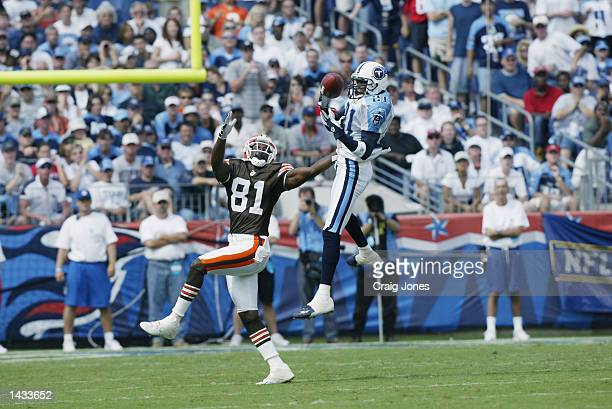 Cornerback Samari Rolle of the Tennessee Titans leaps to knock a pass away from wide receiver Quincy Morgan of the Cleveland Browns during the NFL...