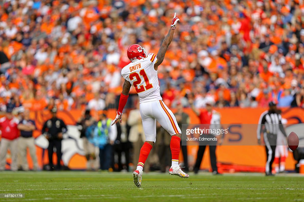 Cornerback Sean Smith #21 of the Kansas City Chiefs celebrates after intercepting a pass against the Denver Broncos at Sports Authority Field Field at Mile High on November 15, 2015 in Denver, Colorado.